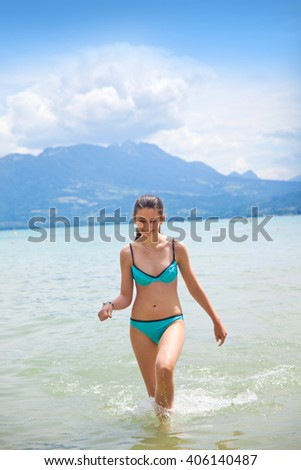 Teenage girl in the lake Annecy, France, region Houte Savoy