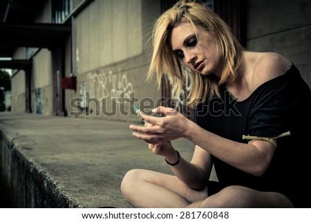 Teenage girl injecting drug - stock photo