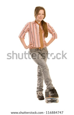 Teenage girl is standing by the skateboard, isolated on white background