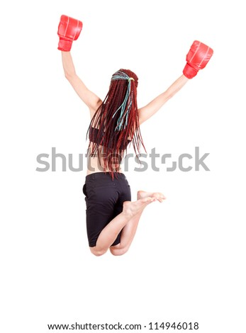 teenage girl jumping with boxing gloves, full length, white background - stock photo