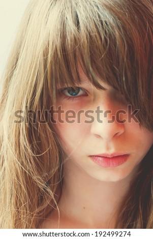 Teenage Girl looking at the camera; toning effect, closeup portrait - stock photo