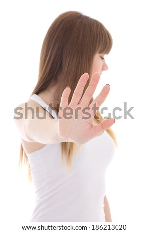 teenage girl making a stop sign with hand isolated on white background - stock photo