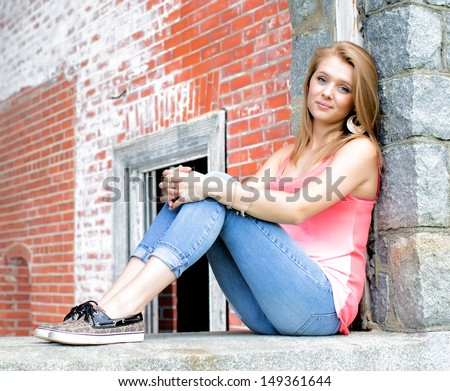 Teenage Girl old stone and brick wall in background - stock photo