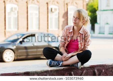 Teenage girl on a city street - stock photo