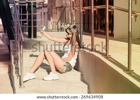 Teenage girl on her mobile phone - stock photo