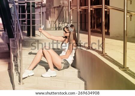 Teenage girl on her mobile phone - stock photo