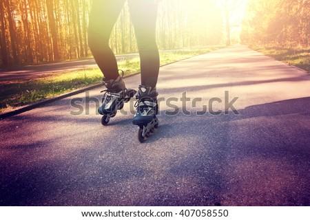 Teenage girl on roller skates at summer. Inline skates sport conceptual image. - stock photo