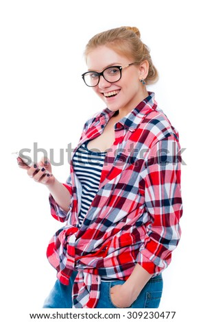 Teenage girl or young woman in glasses looking in camera and laughing