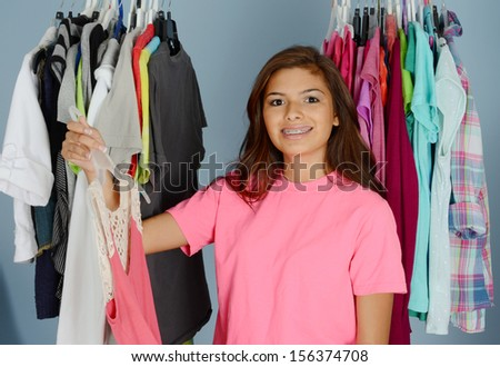 Teenage girl picking out clothes for the day