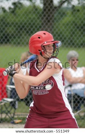 Teenage girl playing softball. - stock photo