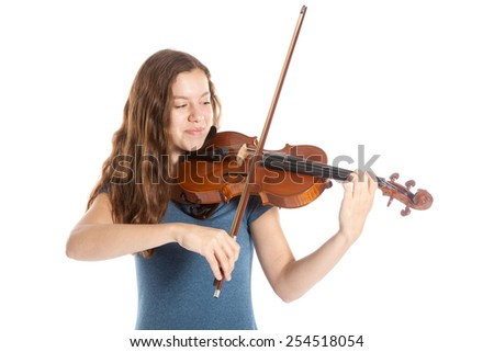 teenage girl plays the violin in studio with white background - stock photo