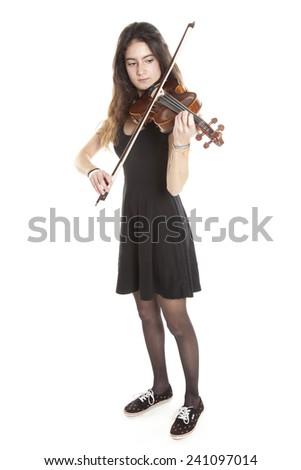 teenage girl plays violin in studio with white background - stock photo