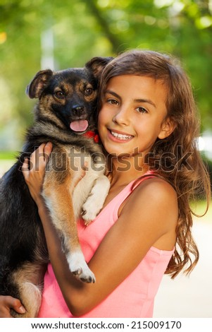 Teenage girl portrait in hugging little dog