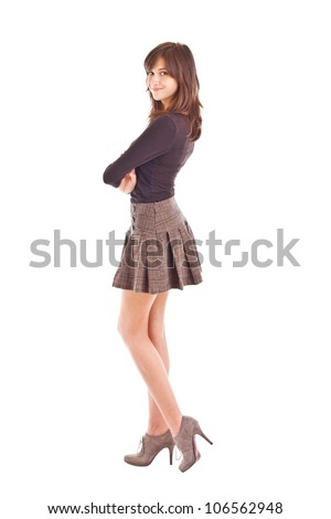 Teenage girl posing in short skirt - stock photo