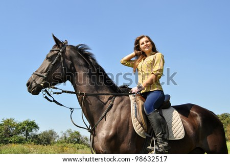teenage girl riding in the summer day