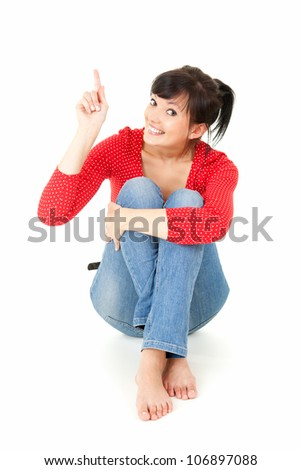 teenage girl showing something, full lenght, white background - stock photo