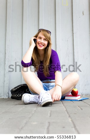 Teenage girl sitting - stock photo