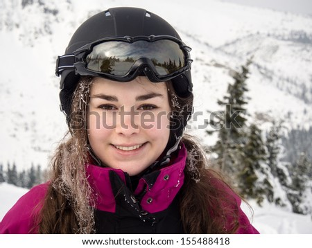 Teenage girl skiing