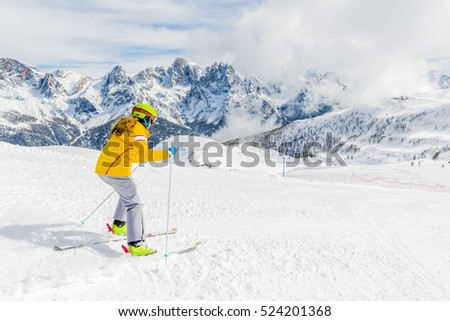 Teenage girl skiing in Italian Alps in Sunny Day, San Martino di Castrozza, Trentino, Italy.