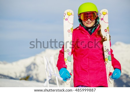 Teenage girl skiing in Swiss Alps in Sunny Day