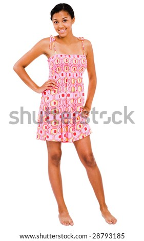Teenage girl standing and smiling isolated over white - stock photo