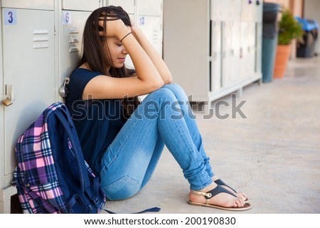 Teenage girl stressed out about some high school drama - stock photo