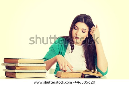 Teenage girl studying at the desk - stock photo