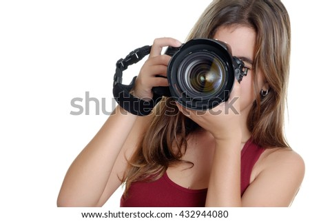 Teenage girl taking photographs with a professional camera isolated on a white background - stock photo