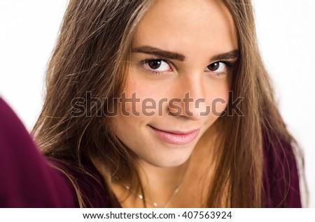 Teenage girl taking selfie - stock photo