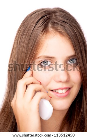 Teenage girl talking on the mobile phone, isolated on white - stock photo
