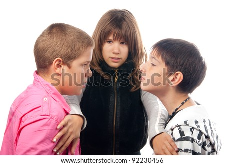 Teenage girl trying to separate two angry teenage boys that want to start the fight. - stock photo
