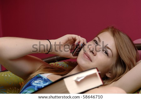 Teenage girl use cellphone in her room. - stock photo