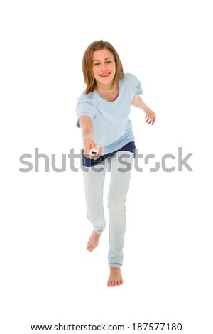 teenage girl using wii - stock photo