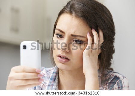 Teenage Girl Victim Of Bullying By Text Message - stock photo