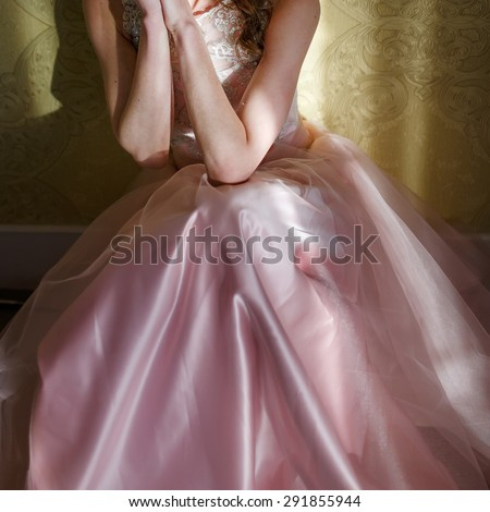 Teenage girl wearing fancy prom pink dress, posing on  school-leaving party.  - stock photo