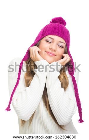 Teenage girl wearing pink hat daydreaming - stock photo