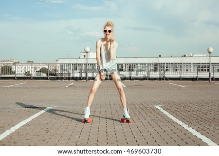 Teenage girl wearing roller skates having fun on sidewalk in city