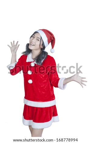 Teenage Girl with beautiful long curly hair. She is wearing a Santa hat. - stock photo