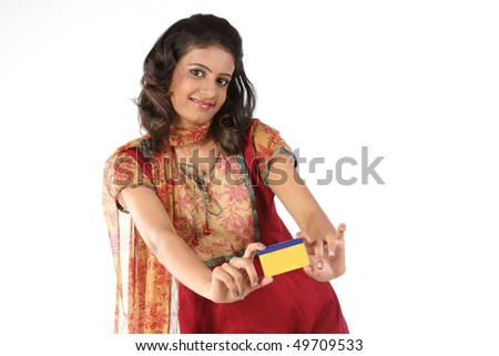 Teenage girl with credit card - stock photo