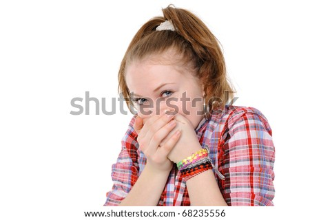 teenage girl with hand over mouth on a white background - stock photo