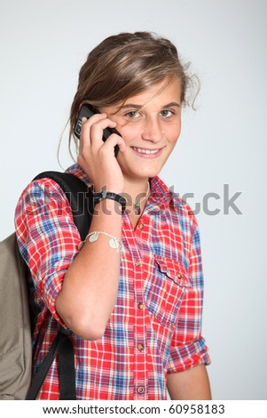 Teenage girl with mobile phone - stock photo