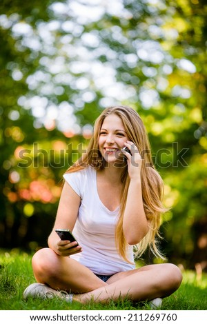Teenage girl with 2 mobile phones - mobility and multitasking concept - stock photo