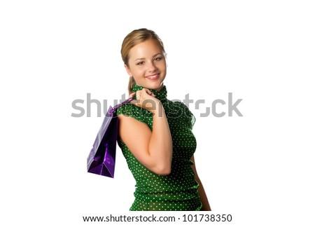 Teenage girl with purple shopping bags - stock photo