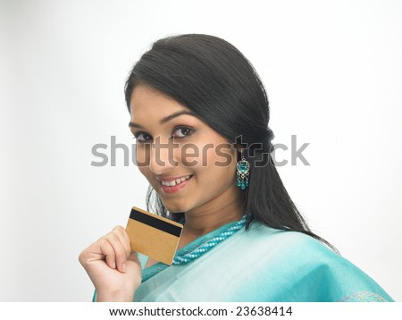 Teenage girl with sari holding the credit-card - stock photo