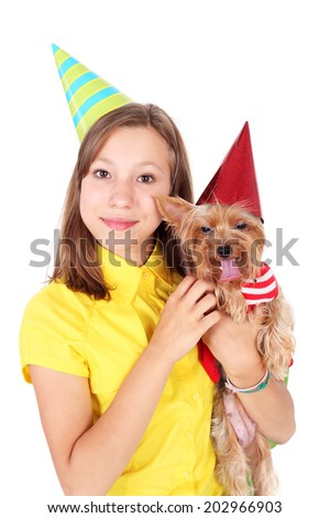 teenage girl with the cute little puppy having a party