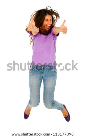 teenage girl with thumbs up jumping - stock photo