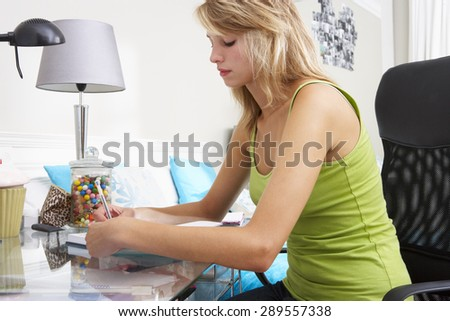 Teenage Girl Writing In Diary