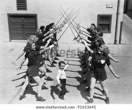 Teenage girls and little boy fencing - stock photo
