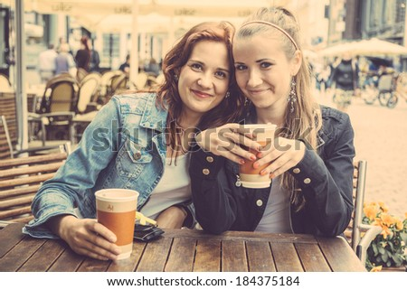 Teenage Girls Drinking at Bar - stock photo