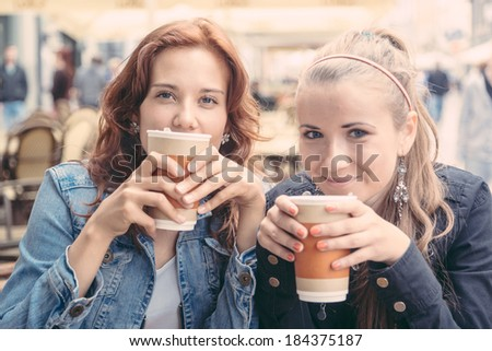 Teenage Girls Drinking at Bar